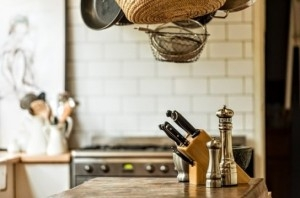 a picture of a kitchen with knives in focus