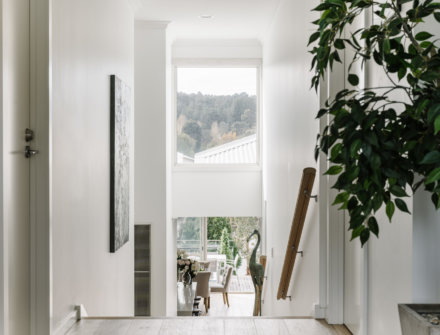 Hallway with lots of natural light at Province Lake House, Daylesford